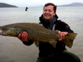 Ian Overbey has a reason to smile holding his Huge trout from Lake Thingvellir, Iceland
